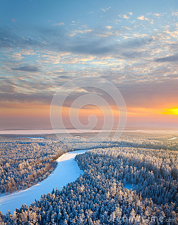 Top view of forest river at winter morning