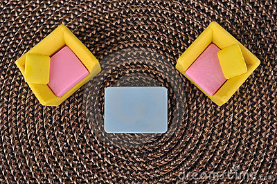 Top view of furniture toy on grass intertexture