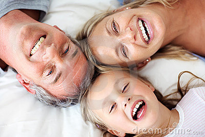 Top view - Happy family lying on the bed