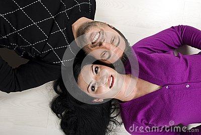 Top view of  happy young couple on floor