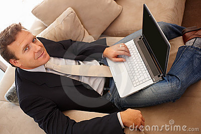 Top view of a mature business man using a laptop