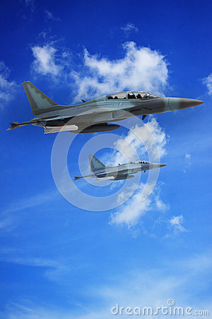 Top view of Military jet plane flying over sky