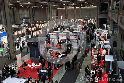 Top view of people and booths at Smau exhibition in Milan, Italy Editorial Stock Image