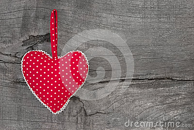 Top view of red dotted heart decoration on wooden background - c
