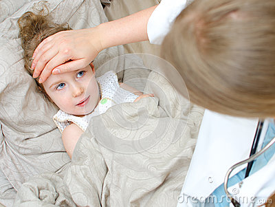 Top view of sick child lying in bed