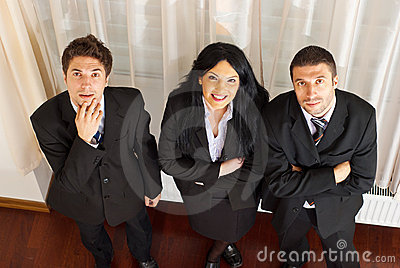 Top view of three business people looking up