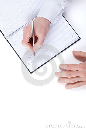Top view of writing hand of businessman