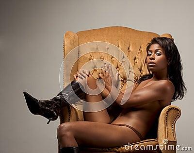 Topless ethnic Latina sensual woman on chair