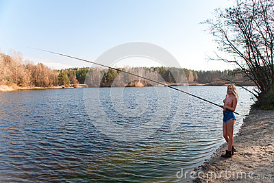 Topless girl fishing at the river royalty free stock image for Topless girls fishing