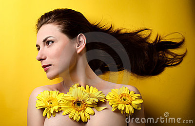 Topless woman covered with flowers