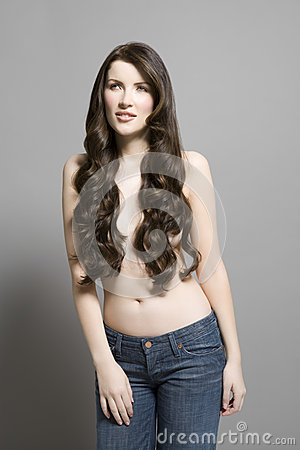 Free Topless Woman In Jeans With Long Brown Wavy Hair Royalty Free Stock Photography - 33900477