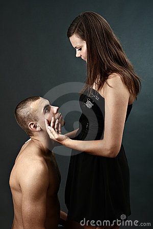 Topless young man kneels before his girlfriend