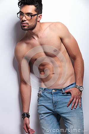 Topless young man looking away