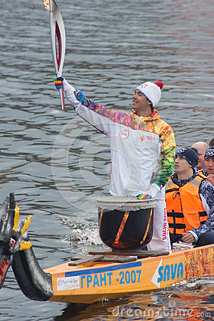 Torchbearer on a boat with dragon head Editorial Stock Photo