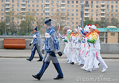 Torchbearers in the Gorki park in Moscow Editorial Photography