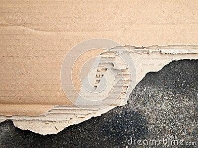 Torn brown cardboard paper