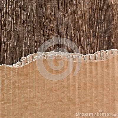 Free Torn Cardboard Packaging On A Wooden Surface Stock Photos - 53267263