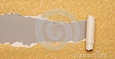 Torn gold paper