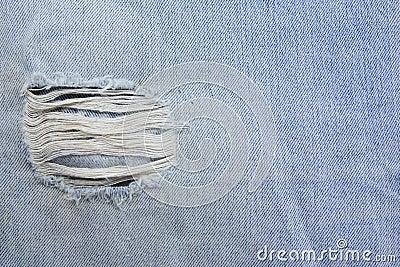 Torn old blue jeans