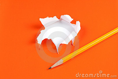 Torn orange paper hole. Tearing Inside white