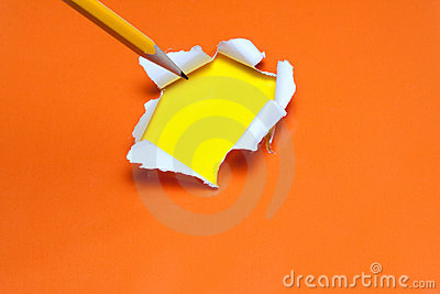 Torn orange paper hole. Tearing Inside yellow