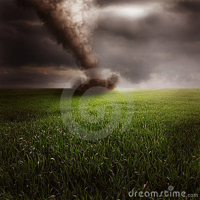Tornado in green field