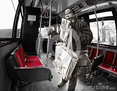 Woman riding the TTC in Toronto Editorial Photo