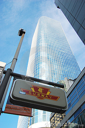 Toronto Subway Sign and skyscraper Editorial Stock Image