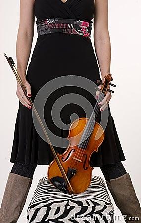 Torso Resting Violin Instrument on Ottoman
