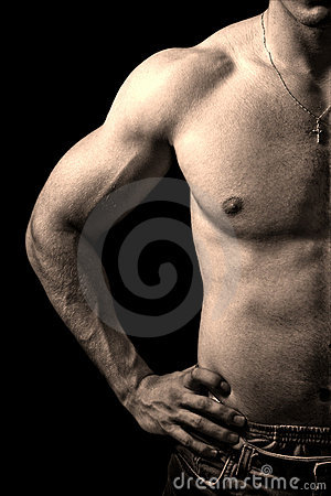 Torso of muscular man isolated on black