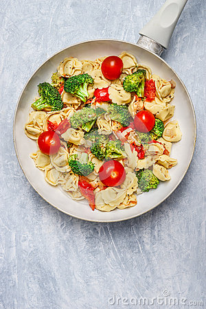 Free Tortellini With Tomatoes And Vegetables Sauce In White Frying  Pan, Close Up Royalty Free Stock Image - 60667276