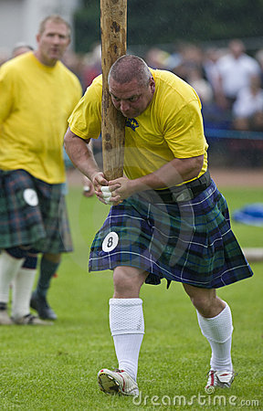 Tossing the Caber - Highland Games in Scotland Editorial Image