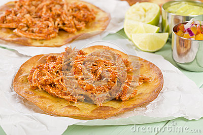 Tostadas - Mexican crispy corn tortilla topped with chicken tinga ...