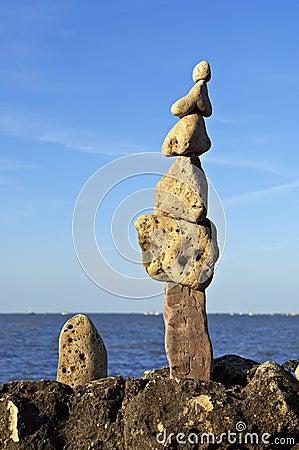 Totem of zen stones on beach