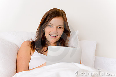 Touch screen tablet computer - woman in bed