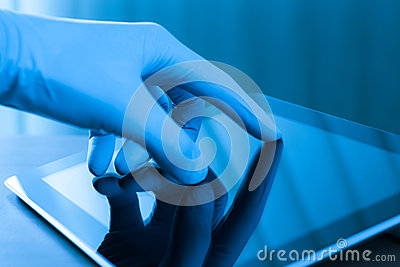 Touching Digital Tablet In Glove