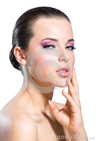 Touching face naked girl with bright pink make-up