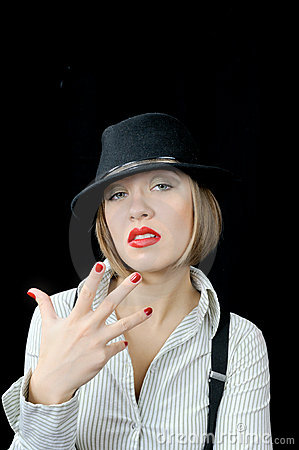 Tough girl in hat shows fingers