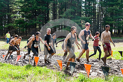 Tough Mudder: Muddy Group of Racers Editorial Stock Photo