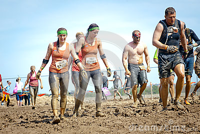 Tough Mudder: Muddy Team of Racers Editorial Stock Photo