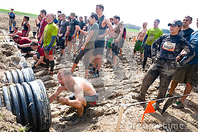 Tough Mudder: Racers Entering the Boa Constrictor  Editorial Stock Image