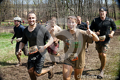 Tough Mudder: Racers Having Fun Getting Muddy Editorial Image