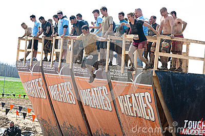 Tough Mudder: Racers Jumping off Walk the Plank Editorial Image