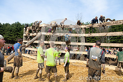 Tough Mudder: Racers Waiting to Climb the Wall Editorial Photo