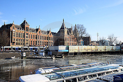 Tour boats near dutch railway station, Amsterdam Editorial Photography