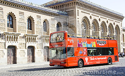 Tour bus at the train station in Toledo, Spain Editorial Image