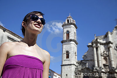 Tourism: happy woman smiling in Havana, Cuba