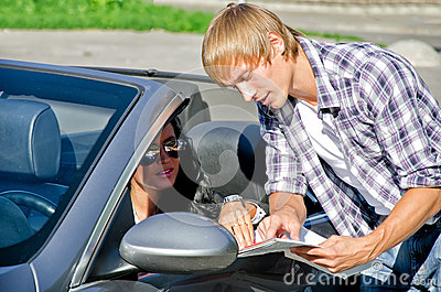 Tourist asking female driver about direction