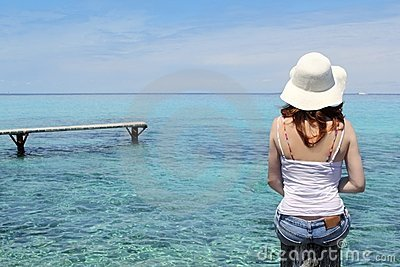 Tourist back woman in Formentera turquoise sea