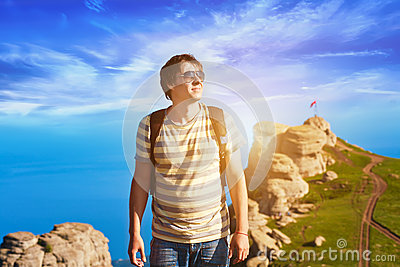 Tourist on the background of clouds and mountain